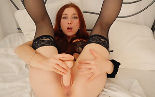 Gorgeous redhead makes her creamy pussy cum.