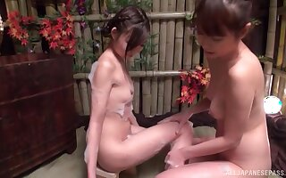 Excellent Japanese lezzie play in soapy XXX scenes