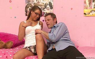 Teen slut with glasses Natasha Vega blows and rides dick