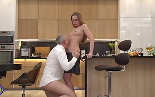 Old guy with a long dick banged hot teen Nika in the kitchen