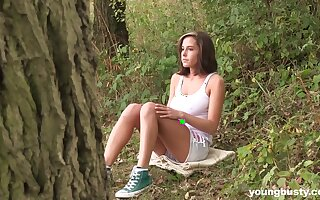 Busty brunette amateur teen Anabelle masturbates solo in the forest