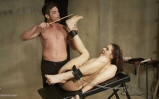 Chained up and pussy tortured submissive teen brunette slut