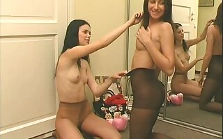 Two lusty girls with long hair and natural tits look sexy in pantyhose