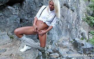 Blonde tourist Claudia Macc is ready for some stripping outdoors and hot solo