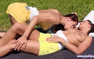 Alfresco lesbian dalliance for teen dolls Christy Charming and Kari K.